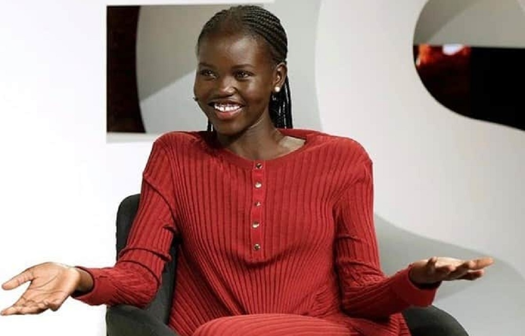 South Sudanese-Australian model, Adut Akech, speaking in an interview [Photo via Facebook]
