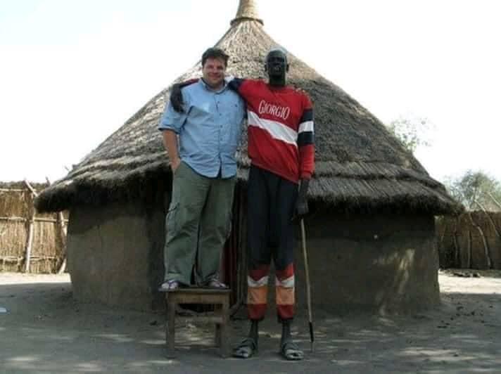 Dinka man hugging his white friend