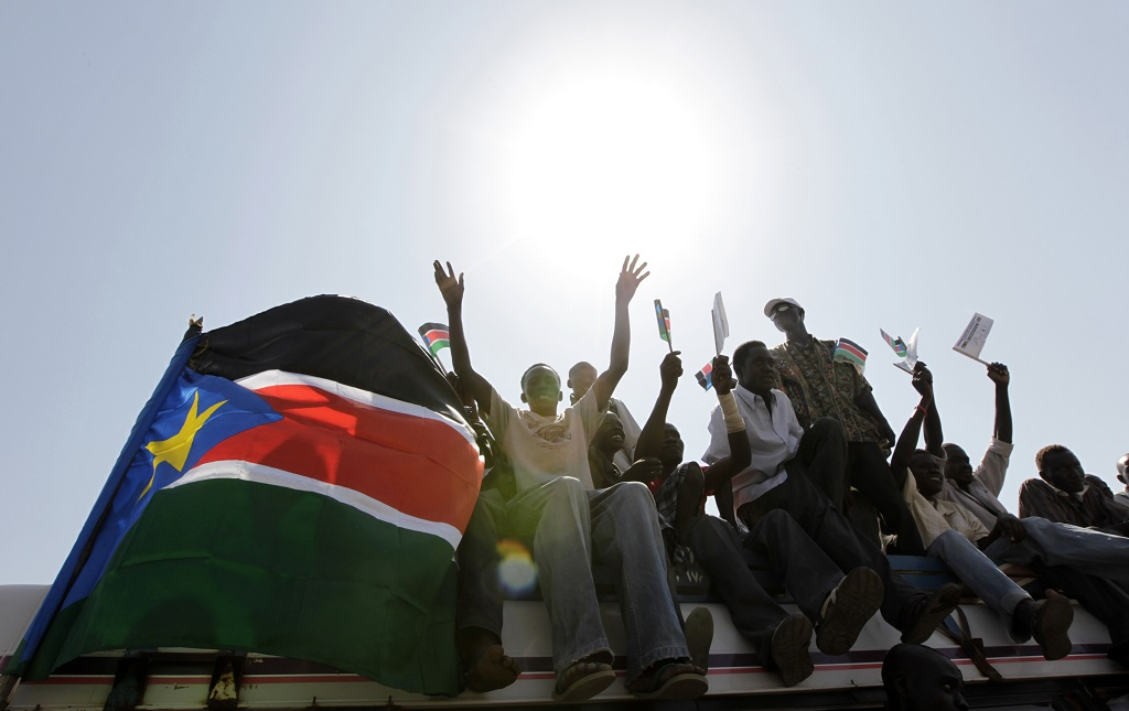 South Sudan youth ride atop a bus as they chant slogans in support of the referendum on southern independence in Juba, January 4, 2011. [Photo credit REUTERS]