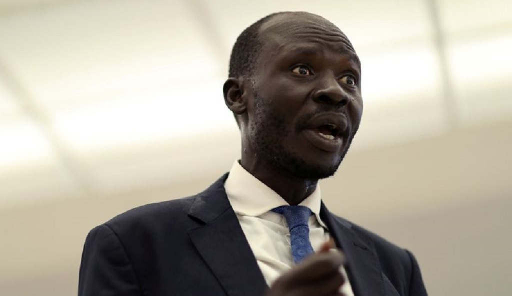 South Sudanese economist Peter Biar Ajak speaks to Reuters as he arrives at Dulles International Airport in Virginia, after fleeing Kenya with his family to the U.S., July 23, 2020. [Photo by REUTERS]