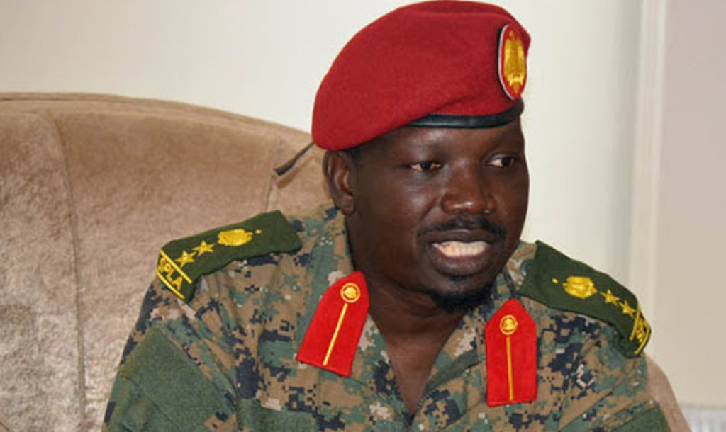 SPLA-IO spokesman Col. Lam Paul Gabriel speaking to the press in Juba [Photo via Getty Images]