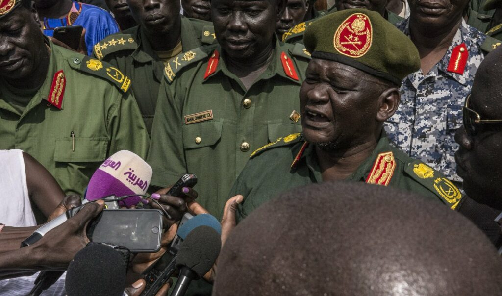 SPLA-IO chief of  staff General Simon Gatwich Dual speaking to reporters following arrival at Juba airport  on April 25, 2016, a day before Machar return to Juba in 2016. [Photo by Radio Miraya]
