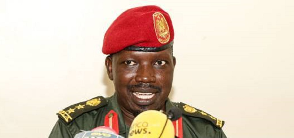 SPLA-IO deputy spokesman Col. Lam Paul Gabriel speaks to media about the progress and challenges facing the transitional security arrangement in Juba on October 2, 2019. [Photo by Getty Images]