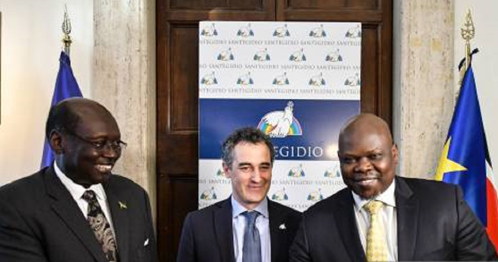 South Sudan Presidential advisor and envoy Dr. Barnaba Marial Benjamin, left, and Real-SPLM chairperson Pagan Amum, right, shake hands during signing of Rome Declaration on January 13, 2020 in Rome, Italy [Photo by Getty Images]