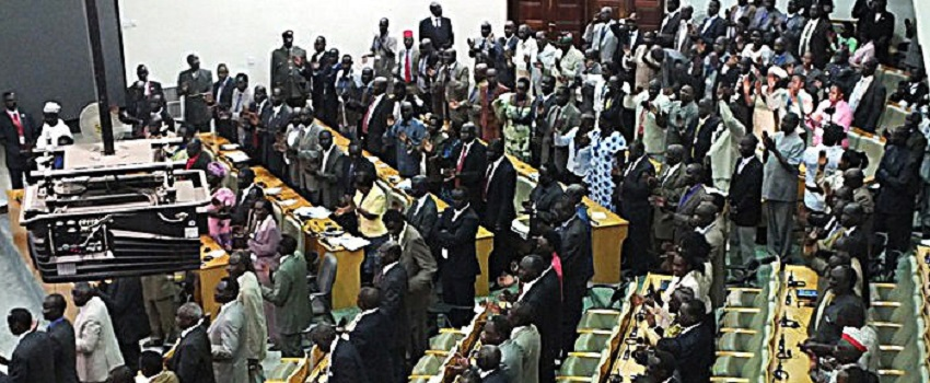 South Sudan legislators applaud as President Salva Kiir (unseen) addresses parliament on April 12, 2012 in the capital Juba. [Photo by WAAKHE WUDU/AFP via Getty Images]