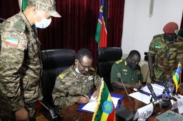 Ethiopian army chief, General Berhanu Jula, and his South Sudanese counterpart General Johnson Juma signing military deal in Addis Ababa [Photo by EN]