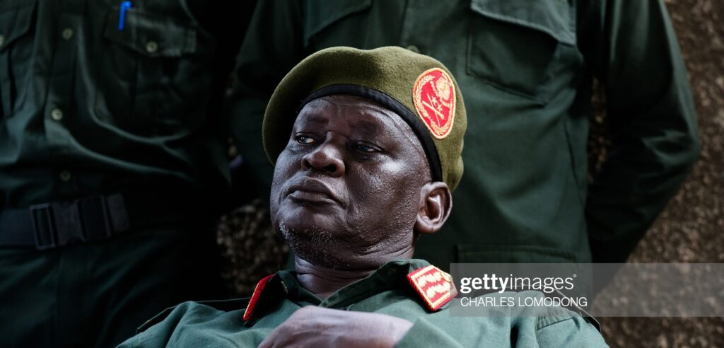 SPLA-IO General Chief of Staff General Simon Gatwech Dual talks to the press at a cantonment site following his return to Juba on April 25, 2016 [Photo by Charles Lomodong/AFP via Getty Images]