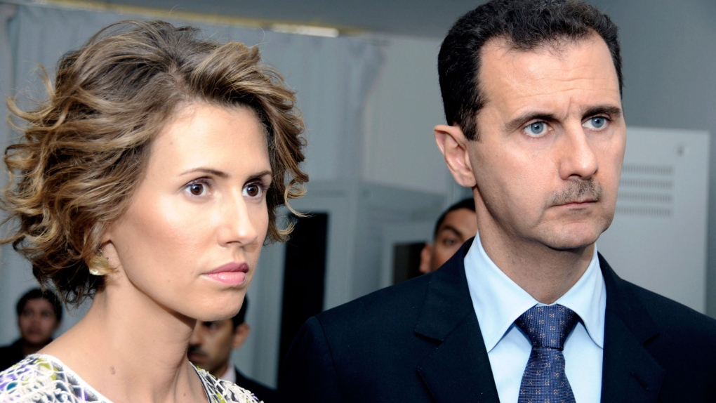 Syrian President Bashar Assad, right, and his wife Asma Assad, listen to explanations as they visit a technology plant in Tunis. [Photo by AP Photo/Hassene Dridi]