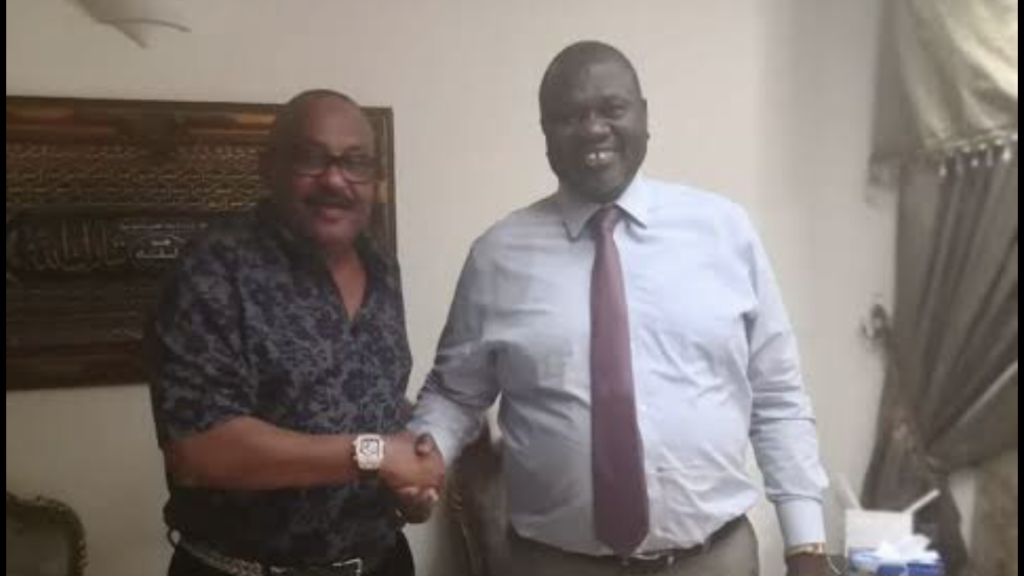 Ashraf Seed Ahmed Hussein Ali, also known as Al Cardinal (left) shakes hands with FVP Dr. Riek Machar Teny in Juba [Photo by unknown]
