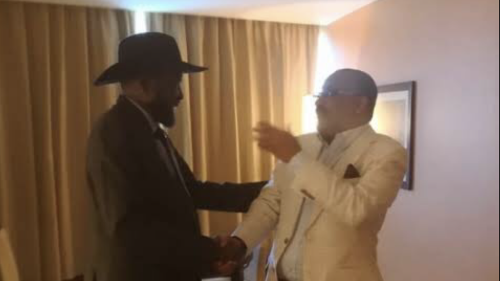 Ashraf Seed Ahmed Hussein Ali, also known as Al Cardinal (right) shakes hands with President Salva Kiir Mayardit in Juba [Photo by unknown]