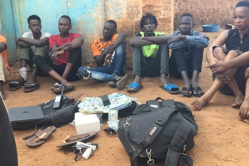 The suspects accused of burglary at the residence of Wau Catholic Bishop early this month are paraded with some of the recovered items on Saturday [Photo via Eye Radio]