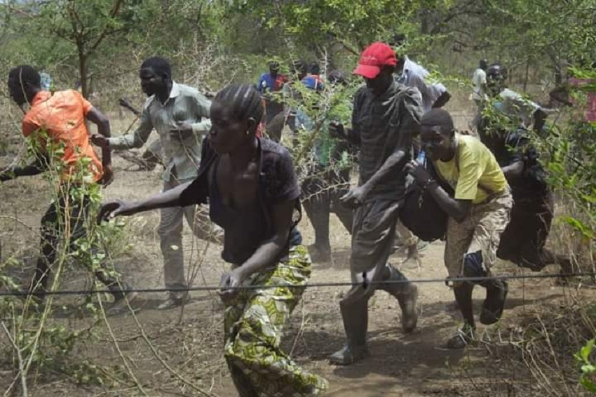 Civilians hiding in the jungle as they flee gunshots in an undisclosed location in South Sudan [Photo by unknown]