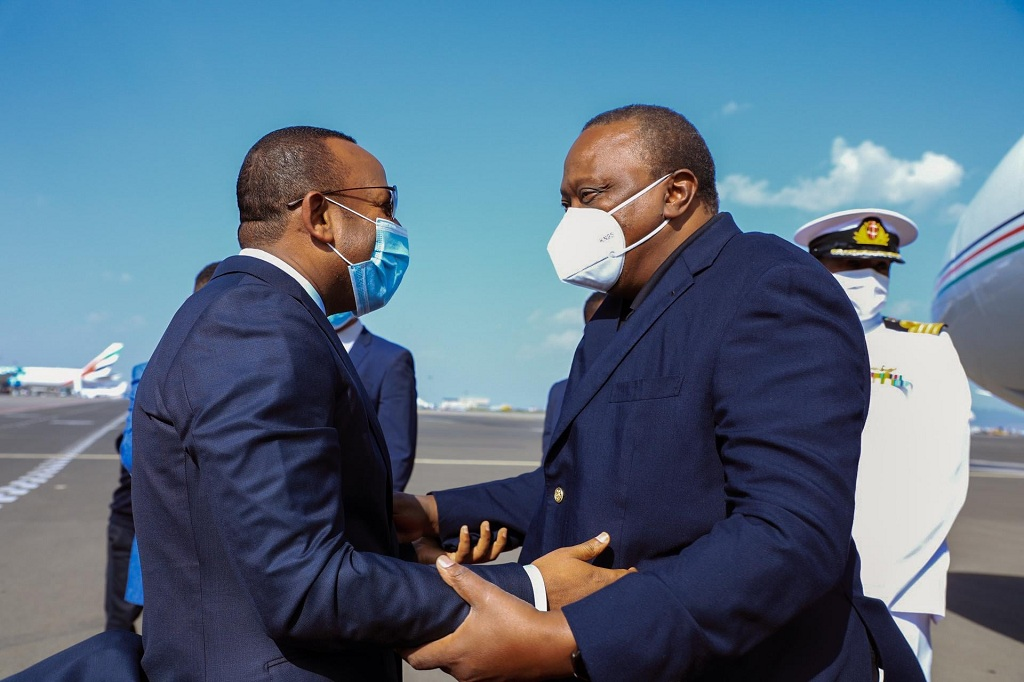 Ethiopian Prime Minister Dr. Abiy Ahmed (left) welcoming Kenyan President Uhuru Kenya at Bole International Airport on June 8, 2021. [Photo by Ethiopian foreign ministry]