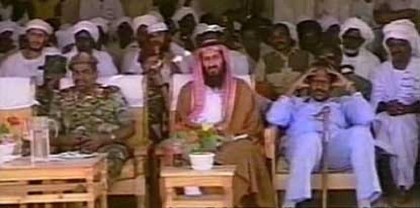 Former leader of Al Qaeda Osama Bin Laden (center) seen during a function alongside Sudanese President Omar al Bashir (left) in Khartoum in 1998. [Photo from YouTube screen grab]
