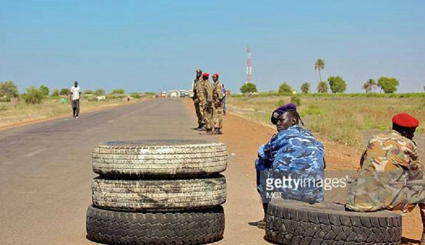 Soldiers manning a checkpoint along Juba-Nimule road [Photo via Getty Images]