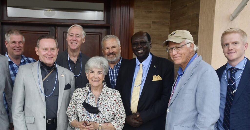 Members of US Congress posting for a photo with presidential minister Barnaba Marial Benjamin. [Photo via presidency]