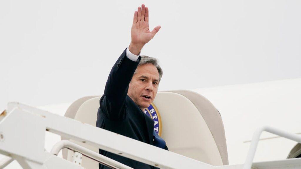 Secretary of State Antony Blinken waves as he departs, Monday, May 24, 2021, at Andrews Air Force Base, Md. Blinken is en route to the Middle East. [Photo by AP via Al Arabiya]