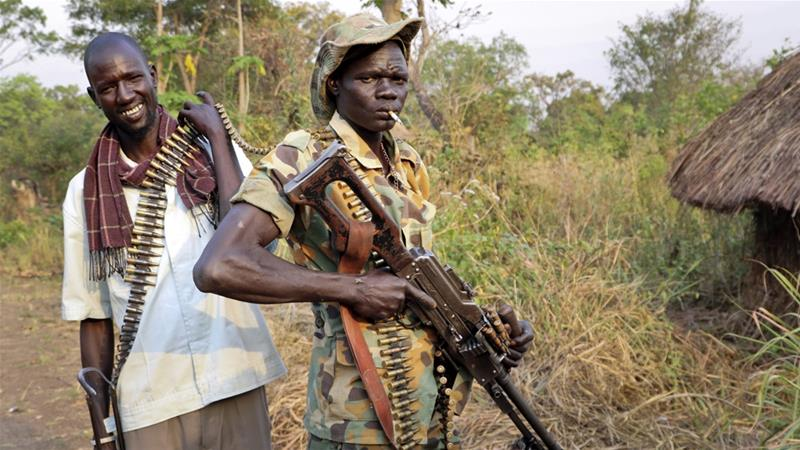 Armed civilians seen in an unidentified location in South Sudan. [Photo via The Sun News Online]