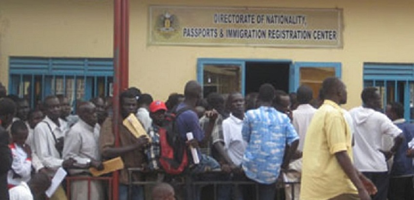 People wait outside the citizenship office in Juba to apply for South Sudanese nationality certificates [Photo by Refugees International/the Guardian]